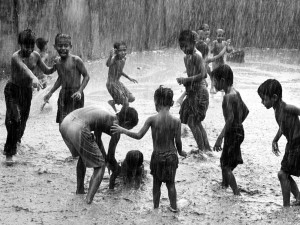 children-play-rain-india_18731_990x742
