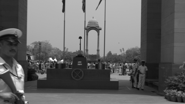 India Gate! It is a symbol of national pride. Not just walls but the story of a war….that killed millions of innocent soldiers. They died in the name of the nation perhaps even without having a chance to live for it or without knowing whose war it was.  From across the world travellers visit and click selfies to keep memories. Many of these photos will perhaps adorn the walls of their homes just the way the wall of this war memorial is decorated with the names of soldiers! At 45°C temperature there is a constant struggle going on : while the attendant soldiers guard the memorial flame many local vendors await customers with the hope of earning a few pennies. Is the war really over? Is it possible to end the war against hunger – a war that compels many to die each day inside our nation!