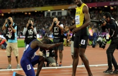 US Sprinter Justin Gatlin bows before Jamaica's Usain Bolt after winning the 100m final at the World Athletics Championships in London on Saturday.