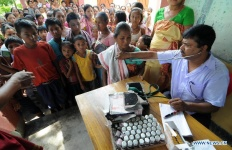doctor treating a patient in a rural village school