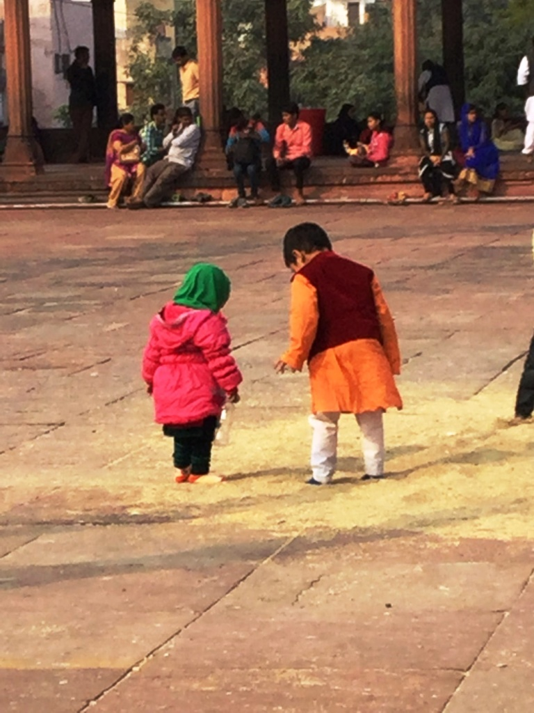 Amidst the visiting crowds and the chaos of the city we spot a beautiful miracle of God. A little boy guides his younger sister on the way to the mosque with utmost care and love. In their companionship and the bond of mutual trust we discover the beauty of life itself. Photography: Kavya