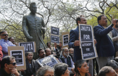 Teachers gather near a statue of Jawaharlal Nehru during a protest at the Jawaharlal Nehru University against the arrest of a student union leader in New Delhi, India, Tuesday, Feb. 16, 2016. Students, journalists and teachers protested in the Indian capital Tuesday after a student union leader's arrest and subsequent violence by Hindu nationalists.The uproar has once again sparked allegations that Prime Minister Narendra Modi's government and his Hindu nationalist Bharatiya Janata Party are displaying intolerance and cracking down on political dissent in the name of patriotism. (AP Photo /Tsering Topgyal)